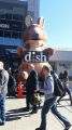 An inflatable Dish Network kangaroo mascot greats CES attendees outside the convention center.