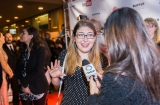 Karen Kavett, who vlogs about graphic design, art school and DIY projects, is interviewed by OMNI on the red carpet.