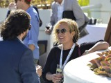 Sunshine and smiles as delegates network during cocktail hour by the pool.