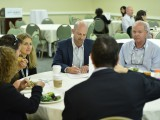 Larry Tanz, CEO of Vuguru, jots down some notes during a networking session.